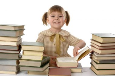 Little girl with books, back to school, isolated over white